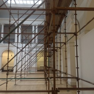 Photo showing side view of scaffolding for the works to build the dividing wall in the Sculpture Court.