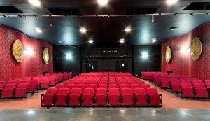 Photo of the plush red velvet seats and black and red wallpapaer of Adam House Theatre