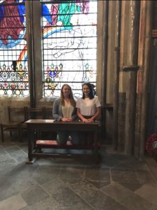 Students at Westminster Abbey with stained glass window for nurses